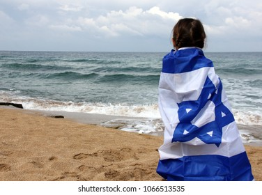 girl wrapped in the flag of Israel