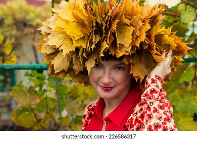 girl with wreath of autumn maple leaves