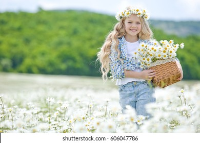 Girl with a wreath in the field