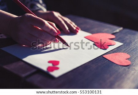 writing love letters to her