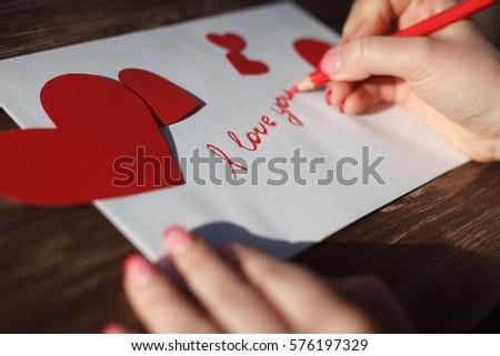 Girl writing i love you on stock photo edit now 576197329 girl writing i love you on love letter on 14 februaryhand made expocarfo Choice Image
