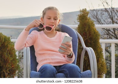 girl writing messages and playing games on the phone