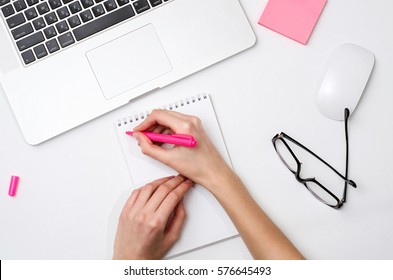 Girl writing in a notebook, workplace, blogging, flatlay photo
