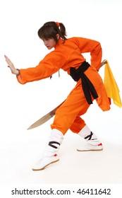 Girl wushu in orange costume