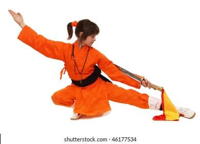 The girl wushu in orange costume in low guard