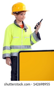 Girl with yellow helmet and radio