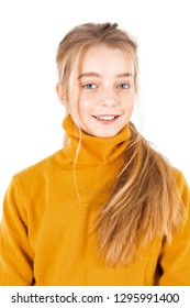 The girl in the yellow jacket is smiling. Portrait.