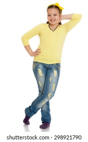 Girl in yellow knitted cardigan and pureed jeans-Isolated on white background