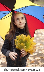 Girl and yellow leaves at autumn