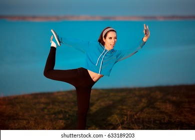 Girl in Yoga Pose Taking a Selfie Outside in Nature - Funny woman posing for her social media profile in a sporty outfit