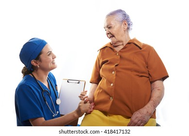 girl young doctor holding old patients hand on white background