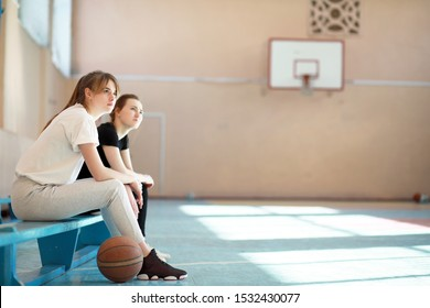 Girl young student in the gym playing a basketball