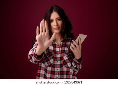 girl or young woman holding mobile phone as internet stalked victim abused in cyberbullying or cyber bullying stress concept and in smartphone and network addiction