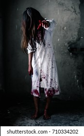 Girl zombie in the blood.The ghost of a woman reaches out and blood. horror of scary fear on hell is monster devil girl in halloween festival concept