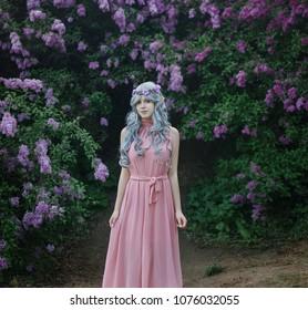 girl-elf walks in a blooming garden