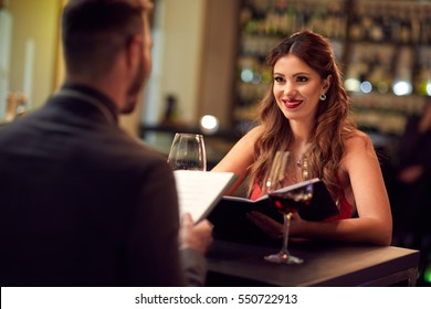Girlfriend with boyfriend celebrate anniversary in restaurant