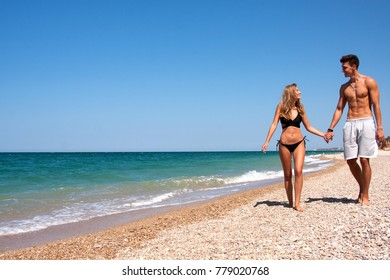 Girlfriend with boyfriend spends time on the beach