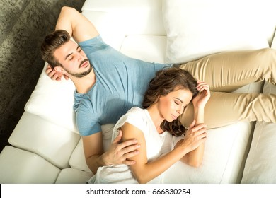Girlfriend resting on the Sofa with her Boyfriend.