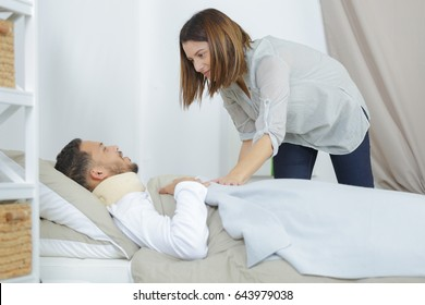 girlfriend takes care of man sick in the on bed
