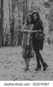 Girlfriends in autumn park