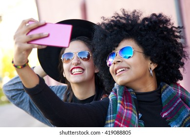 girlfriends doing a selfie with mobile