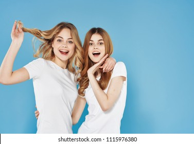 girlfriends happy in white T-shirts on a blue background