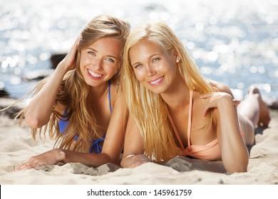 Girlfriends having good time on the beach