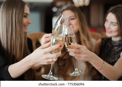 girlfriends rest in a restaurant, drink champagne, dance, sing