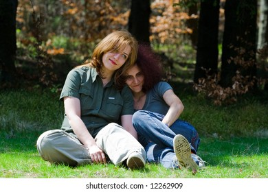Girlfriends sitting in a meadow