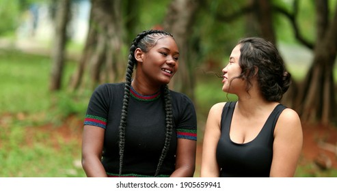 Girlfriends talking outside gossiping at park