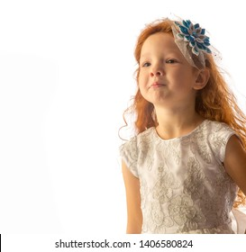 girlie, baby, lass, female child, lassie. The little red-haired girl excites affection, if you want someone to smile, this portrait suits your decision. Download this photo - the key to success.