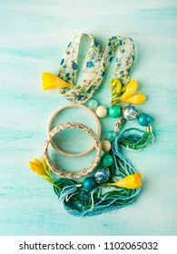Girl's accessories on turquoise pastel background. Flat lay
