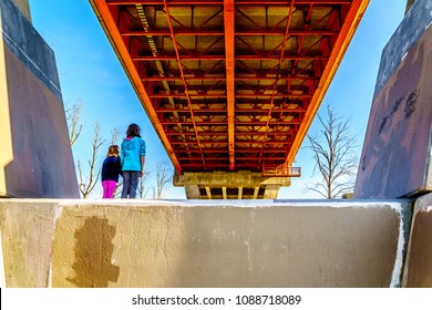 Girls in awe of the Steel and Concrete structure of Mission Bridge over the Fraser River on Highway 11 between Abbotsford and Mission in British Columbia, Canada