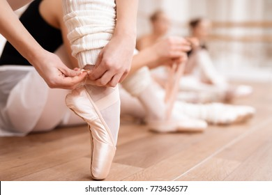 Girls ballet dancers rehearse in ballet class. They train dance moves. They are professional theater actors.
