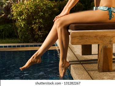 girl's beauty legs in the pool
