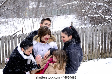 girls and boy playing and celebrating winter