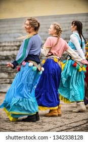 Girls in bright clothes dance on the Slavic holiday Shrovetide. Rezekne - Latvia, March 2019