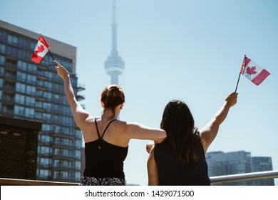 girls with the Canadian flags