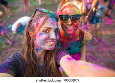 girls celebrate holi festival, make selfie