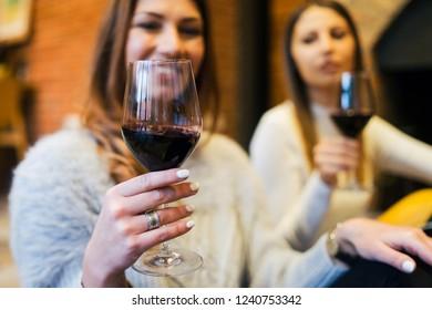 Girls Celebrating with Wine
