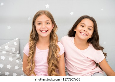 Girls children with long curly hair. Pajamas party concept. Girls just want to have fun. Girlish secrets honest and sincere. Friends kids have nice time pleasant leisure. Best friends forever.
