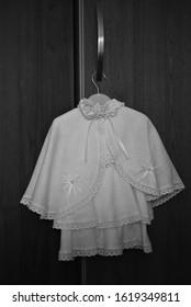 Girls christening dress on a hanger