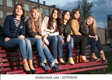 girls in a city park on a bench