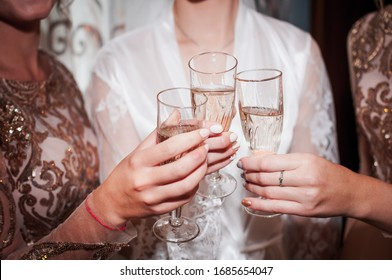 Girls clinking with glasses of champagne