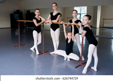Girls communicate in class at the ballet school.
