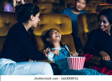 The girls cried loudly in the cinema, causing annoyance to the people sitting next to and behind them.