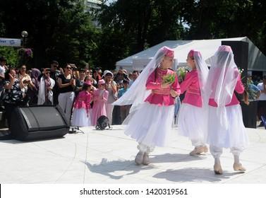 Girls in Crimean Tatar costumes dance during the Kiyv East Fest festival dedicated to the Islamic holiday Ramazan Bayram in Taras Shevchenko Park, in Kiev, June 5, 2019