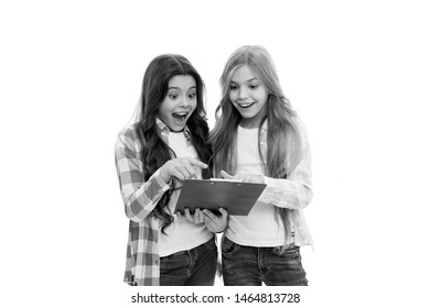 Girls cute pupils got results test. Good school marks. We passed exam. Girls with school textbook white background. School concept. Interesting information. Happy exam results. Here are exam results.