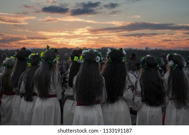 Girls in a dance, people's rite, wreaths on their heads, a holiday of Ivan Kupala