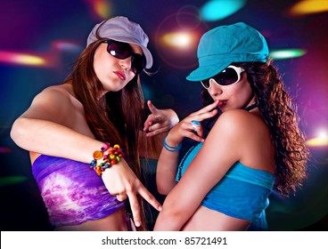 girls dancing in discolight
